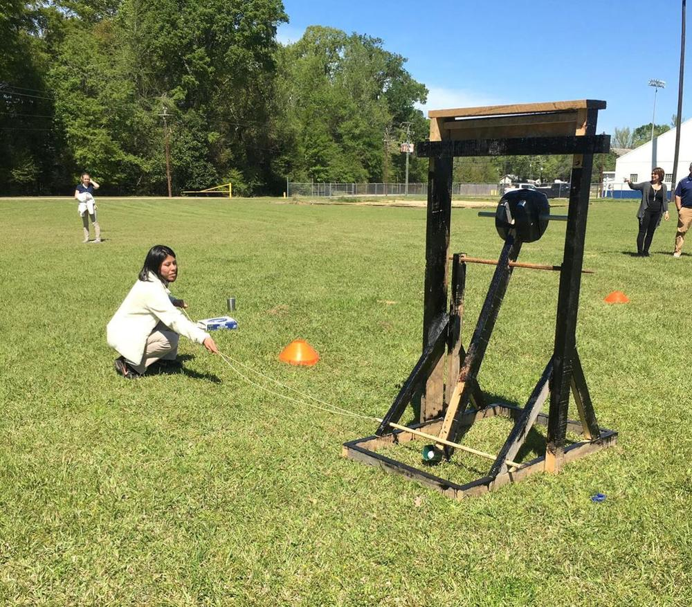 West Feliciana High School physics students learn how trebuchets work