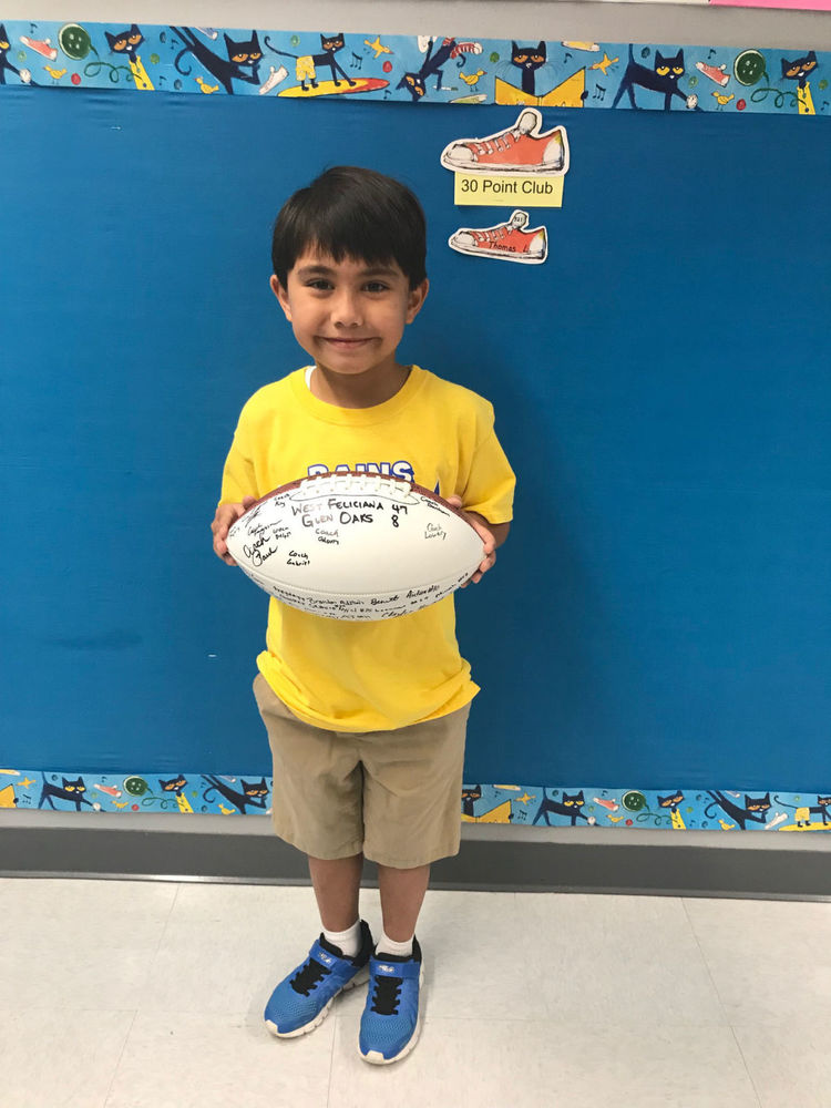 Bains Lower student receives game ball for reading success ADVOCATE STAFF REPORT