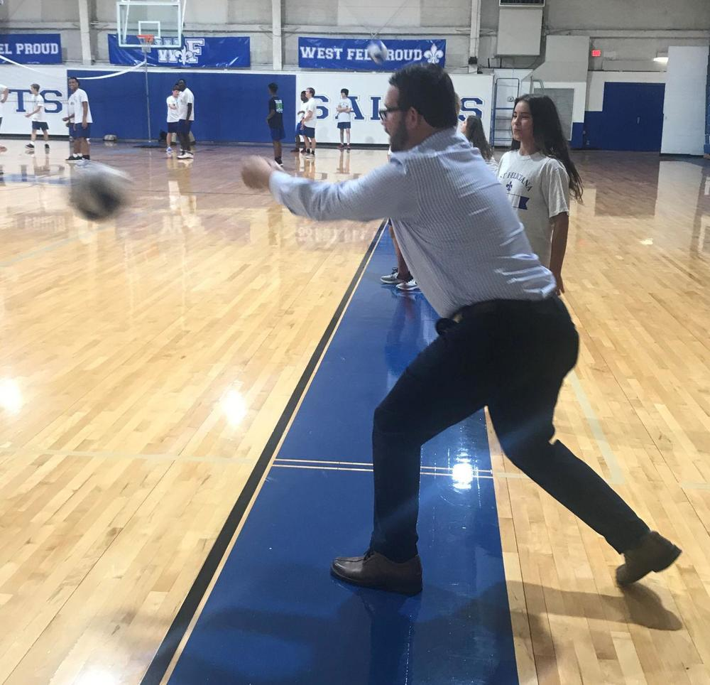 West Feliciana superintendent jumps into volleyball game during a physical education class