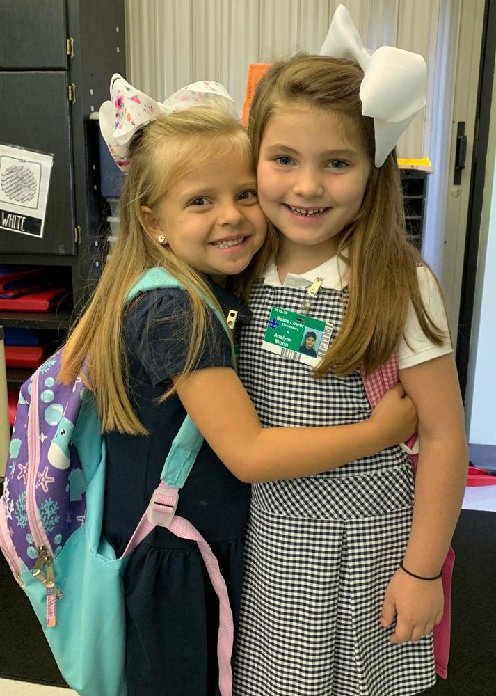 Friends share a hug at Bains Lower Elementary