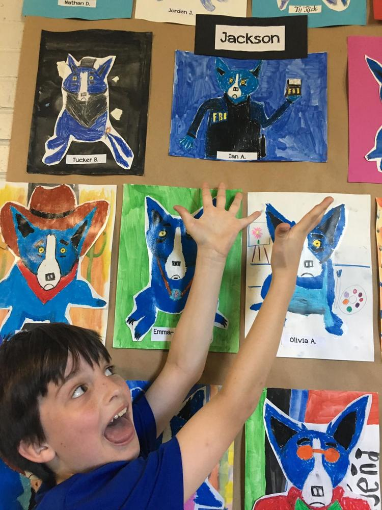 Bains Elementary School students dip their brushes into Blue Dog theme