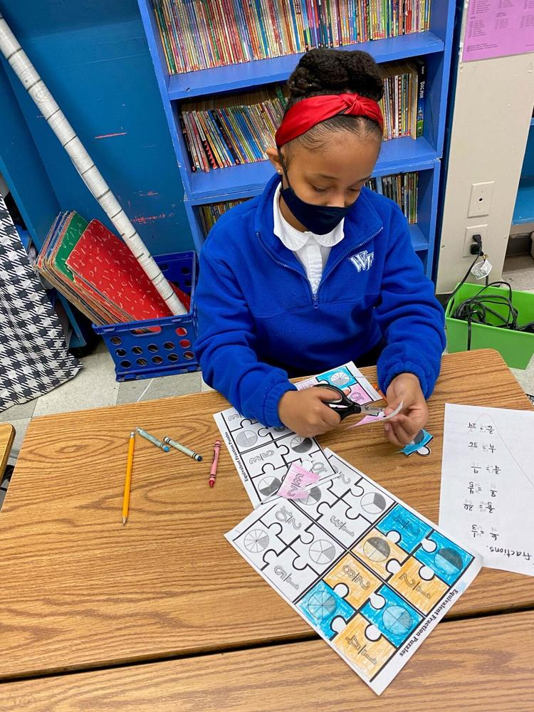 Jigsaw puzzles help students learn fractions at Bains Elementary