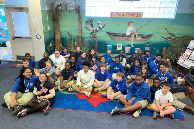 West Feliciana Middle School students read with kids at Bains Elementary