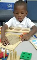 Head start students practice fine motor skills