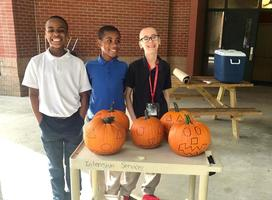 West Feliciana Middle School students prepare pumpkins for Halloween