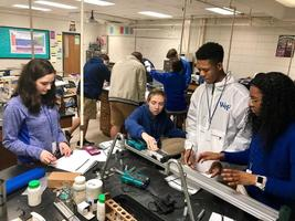 West Feliciana High School physics students examine properties of momentum
