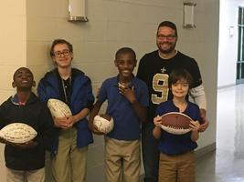 West Feliciana Parish students receive footballs from superintendent at Christmas party