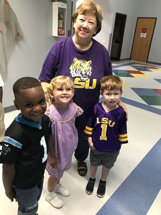 Mrs. Roberts and a few of her students show off their love of their favorite sports team!